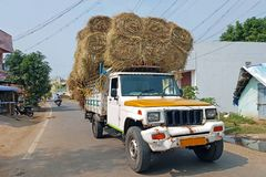 Truck full of hay bales in the streets of Tiruvanamalai India stock photography