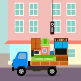 The truck is fully loaded and ready to move. The truck is loaded with household appliances and furniture Royalty Free Stock Photos
