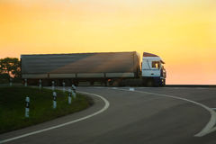 Truck goes on the highway Stock Photo