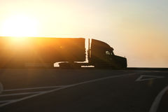 Truck goes on highway on sunset Stock Image