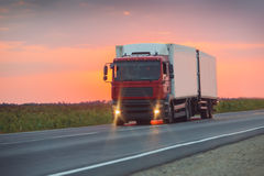 Truck goes on highway on sunset Royalty Free Stock Images