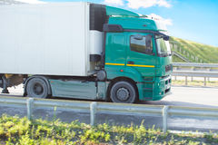 Truck goes on an outcome. Big truck goes on an automobile outcome Stock Images