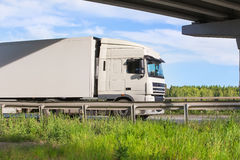 Truck goes on an outcome. Big truck goes on an automobile outcome Royalty Free Stock Images