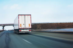 Truck goes on road. Big white truck goes on road Royalty Free Stock Photography