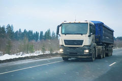 Truck goes on winter road Stock Photos