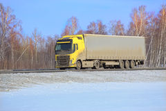 Truck goes on winter snow highway Royalty Free Stock Photos