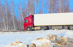 Truck goes on winter snow highway Stock Images
