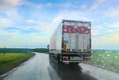 Truck going on the highway to rain Stock Photography