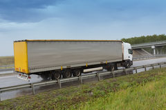 Truck going on the highway to rain Royalty Free Stock Images