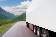 Truck going on mountain road Royalty Free Stock Images