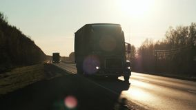 Truck going up steep hill. Vehicle pov shot of semi trailer truck traffic on highway. Truck going up steep hill. Vehicle pov shot of semi trailer truck traffic stock footage