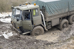 Truck got stuck in the muddy road Stock Image