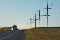 Truck on gravel road and electricity pylons Royalty Free Stock Photography
