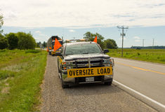 A truck guiding an oversize load Stock Photos