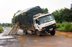 The truck has proplem with much pot hole on highway.BINH PHUOC, VIET NAM- SEPTEMBER 1 Stock Photos