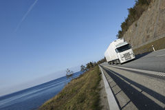 Truck haulage on scenic route Royalty Free Stock Photos