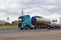 A truck hauling a fuel tanker on bypass road. VOLGOGRAD - JULY 30: A truck hauling a fuel tanker on bypass road. July 22, 2016 in Volgograd, Russia Stock Image