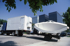 Truck hauling a satellite dish Royalty Free Stock Image
