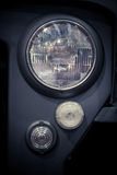 Truck headlight detail. Close up image of a truck headlight with a protective grille Stock Image