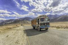 Truck on the high altitude Srinaga-Leh road in Ladakh province Stock Photo