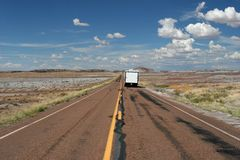 Truck on the highway. Truck transporting goods on desert highway Royalty Free Stock Image