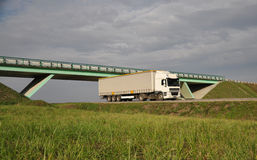 A truck on the highway. Big truck with a trailer on the highway royalty free stock photo