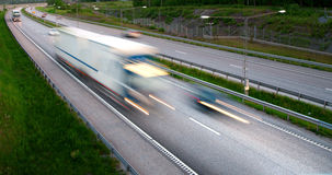 Truck on highway. Truck at high speed blurred motion on highway Royalty Free Stock Image