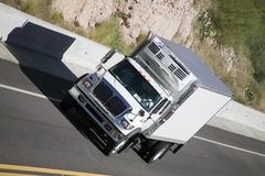 Truck on highway. Delivery truck on highway in desert Royalty Free Stock Images