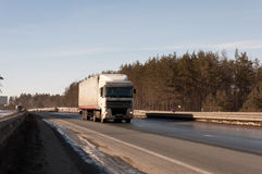 Truck on the highway. Truck with long venchile on the highway. front view Royalty Free Stock Image