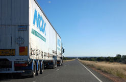 Truck on highway in Australian outback Stock Images