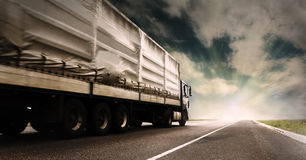 Truck on the highway. Big tented truck on the lonely highway Royalty Free Stock Photography