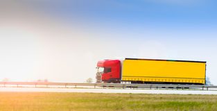 Truck on highway. Red delivery truck passing by on highway Royalty Free Stock Images