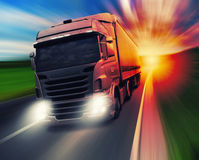 Truck on highway. Cargo truck speeding on highway at sundown Royalty Free Stock Photos