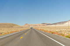 Truck on highway in desert Royalty Free Stock Photography