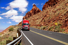Truck on Highway. Red truck moving on Utah highway royalty free stock photo
