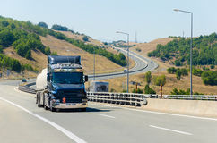 Truck at highway road s curve Stock Images