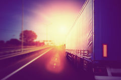 Truck on a highway. Semi Truck In Motion. Speeding Truck on the Highway Royalty Free Stock Image
