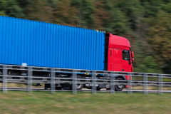 Truck on highway speed blur. A Truck on highway speed blur Royalty Free Stock Photo