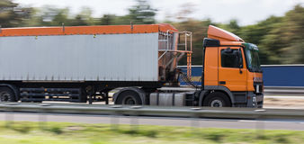 Truck on highway speed blur. A truck on highway speed blur Royalty Free Stock Photography
