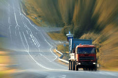 Truck on highway speed, blur. Tracks Royalty Free Stock Photo