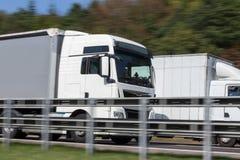 Truck on highway speed blur. Trucks on highway speed blur stock images