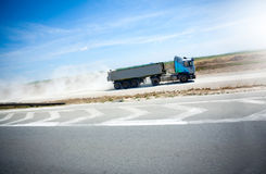 Truck on hill start  road transporting cargo Stock Images