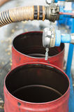 Truck Hoses for fuel station, oil barrels Stock Photography