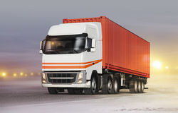 Truck on ice road in blizzard Stock Photography