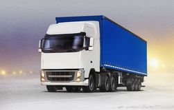 Truck on ice road in snow-storm Royalty Free Stock Photo