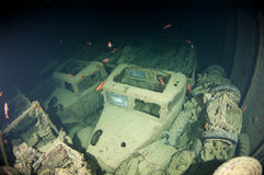 Truck inside the hold of a large shipwreck Stock Image