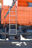 Truck ladder. Ladder on the orange truck Stock Image