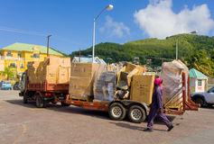 A truck laden with cargo at the ferry jetty on bequia Stock Photo