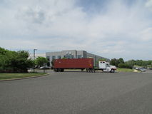 Truck leaving VAG VW Audi Distribution Center in NJ. Flags of USA, Germany and State of New Jersey. Stock Photo