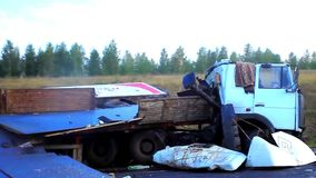 The truck lies in a ditch after the road accident. HD. 1920x1080 stock footage